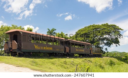 MANACA IZNAGA,CUBA-JULY 22,2014: Tourist train in the Valley of the Sugar Mills or Valle de los Ingenios,  a Unesco World Heritage site and a major tourist landmark n Cuba - stock photo