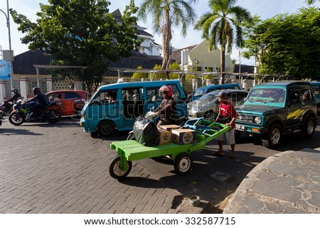 MANADO, NORTH SULAWESI, INDONESIA - AUGUST 5, 2015:  Morning traffic on Manado street on August 5, 2015 in Manado, North Sulawesi, Indonesia