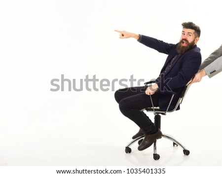 Management, agile business, positive emotions. Happy business, leadership concept. Bearded man with cheerful face has fun on boss chair. Employer, leader or manager smiles and gives orders.