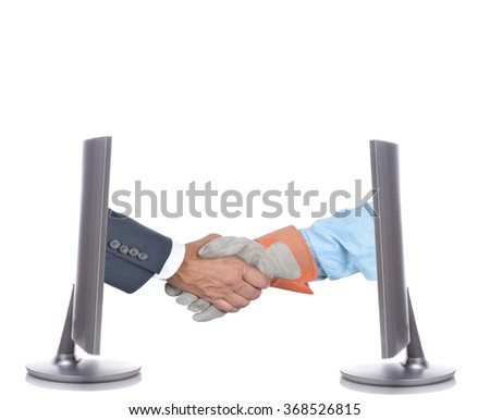 Management and Labor handshake. Two hands one businessman in suit and gloved workers hand coming out of two computer screens. Business Accord Concept. - stock photo