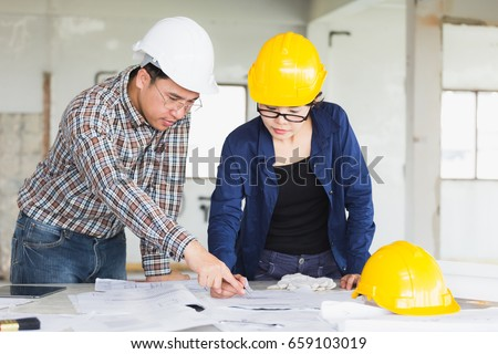 Management consulting engineers foreman working blueprint stock management consulting or engineer and labor woman working with blueprint and drawing on work table in malvernweather Choice Image
