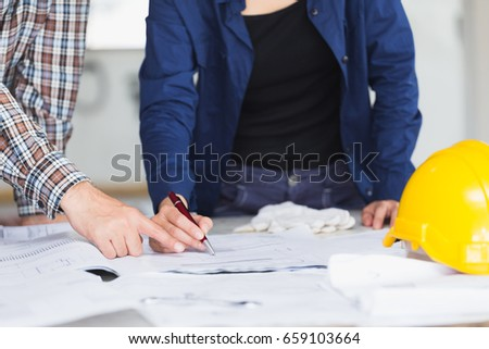 Management consulting engineer labor woman working stock photo management consulting or engineer and labor woman working with blueprint and drawing on work table in malvernweather Choice Image