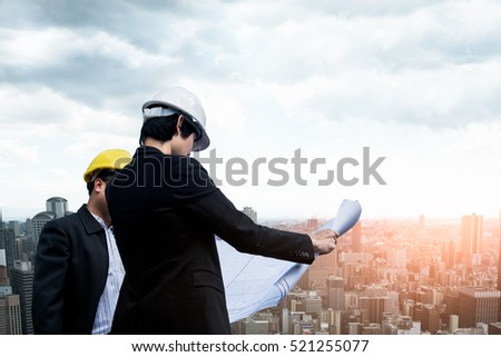 Management consulting people holding blueprint his stock photo management consulting people holding blueprint in his hand and discussion with engineers for construction planning in malvernweather Choice Image
