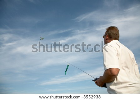 Management of model of the plane on a background of the sky - stock photo