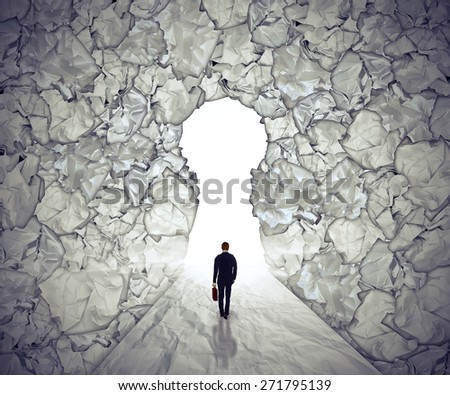 Management solutions concept leadership symbol. Business man walking to glowing key hole shape opening as path to success through crushed and crumpled office paper. Strategy visionary path  - stock photo