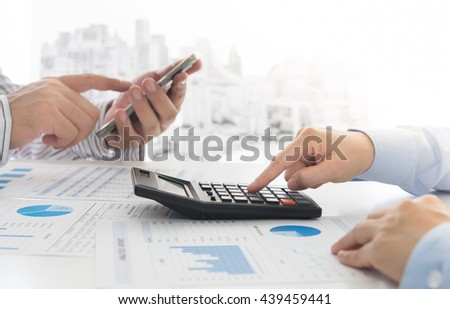 Manager analyze financial numbers to view the performance of the company. Concept of analyze data, business analytics, financial planning, financial services. - stock photo