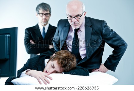 manager and boss discover lazy employee sleeping during day job - stock photo