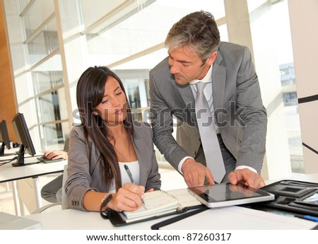 Manager and businesswoman meeting in office - stock photo