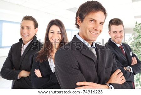 Manager and his team smiling in an office environment