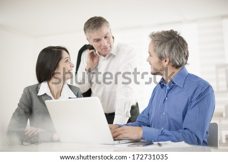 manager and his workteam at office - stock photo