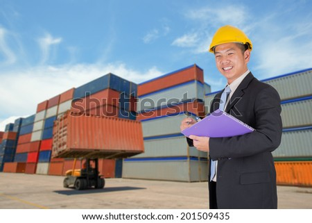 Manager asian business at happy complete job in depot - stock photo