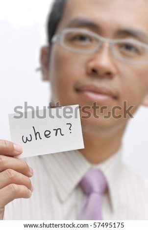 Manager ask you ??when?? and holding one card with words. - stock photo