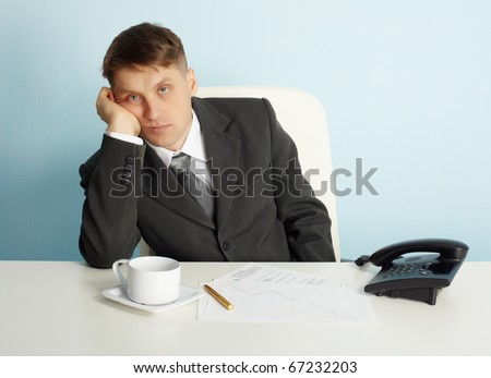 Manager bored in the office without a job - stock photo