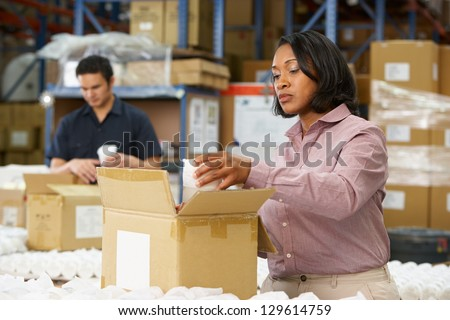 Manager Checking Goods On Production Line - stock photo