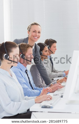 Manager checking the work of the staff in call center
