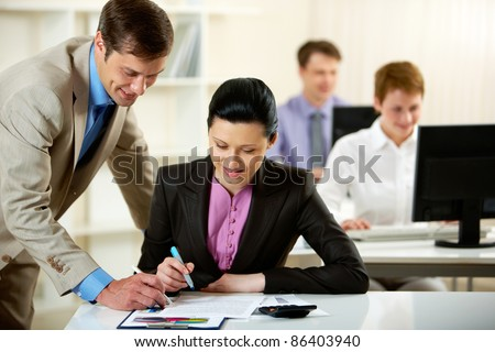 Manager consulting his subordinate about the documents - stock photo