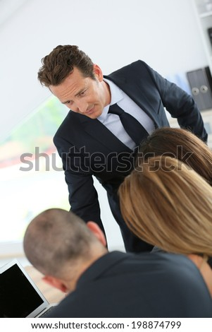 Manager having a meeting with business team  - stock photo
