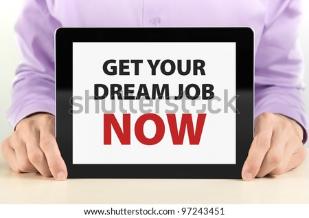 "Manager holding tablet pc with ""Get Your Dream Job Now"" text on screen."