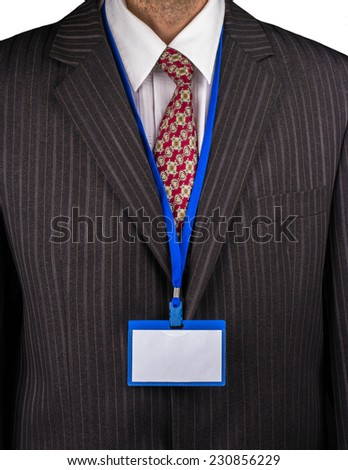 Manager in a suit with a tie and a badge on the neck - stock photo
