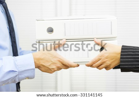 Manager in public administration gives work to employee - stock photo