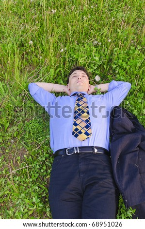 Manager in the Open and is relaxed on a flowery meadow - stock photo