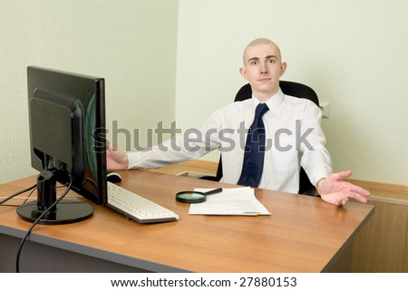 Manager in white shirt on a workplace - stock photo