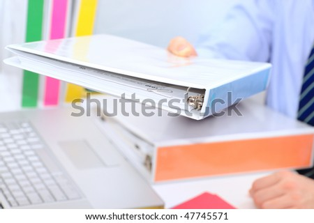 Manager is returning a paperwotk - stock photo