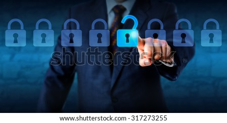 Manager is unlocking a virtual lock in a lineup of eight padlocks. Business concept and technology metaphor for cyber attack, computer crime, information security and data encryption. Copy space. - stock photo