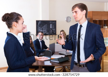 Manager lecturing team member severely at office meeting  - stock photo