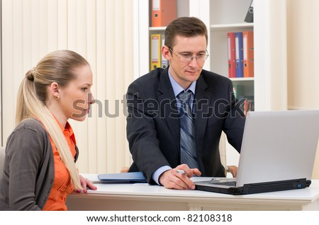 manager man and businesswoman in the office - stock photo