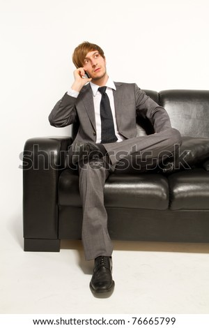 manager on couch - stock photo