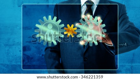 Manager playing off two big male knowledge worker icons versus one female white collar worker via a touch screen interface. The businesswoman is represented by a smaller, vibrant, yellow cog wheel. - stock photo