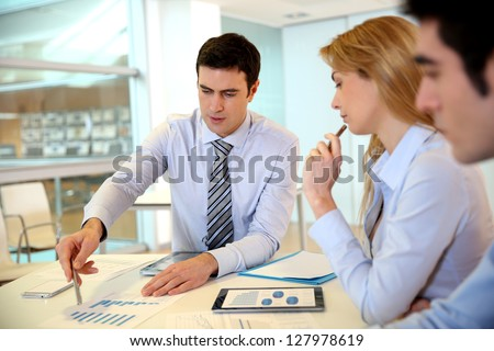 Manager presenting budget to marketing people - stock photo