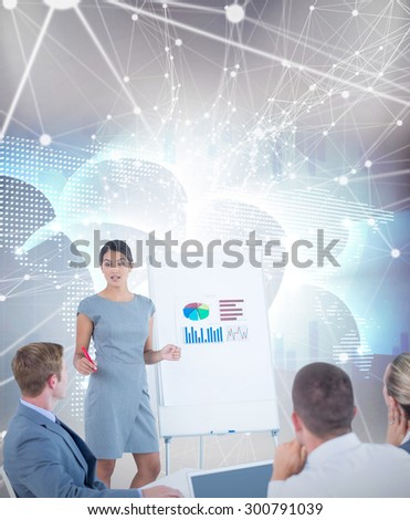 Manager presenting statistics to her colleagues against global business graphic in blue - stock photo