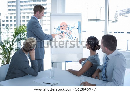 Manager presenting whiteboard to his colleagues against global business interface - stock photo