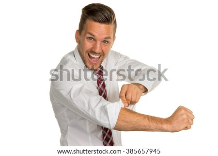 manager rolls up sleeves - stock photo