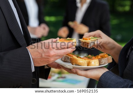 Manager's conversations at the office buffet during lunch - stock photo