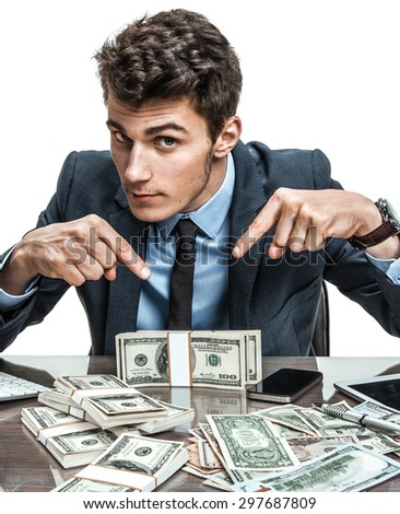 Manager showing his earnings, profit, income, earnings, gain, benefit, margin / modern businessman at his desk with computer and a lot of money - stock photo