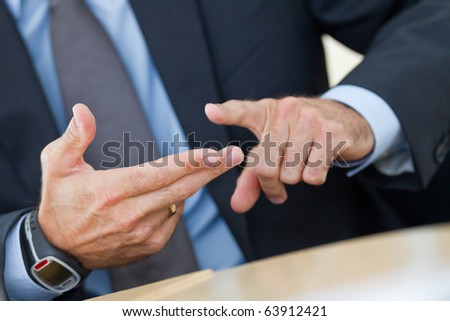 Manager shows three fingers in a conversation to itemize something - stock photo
