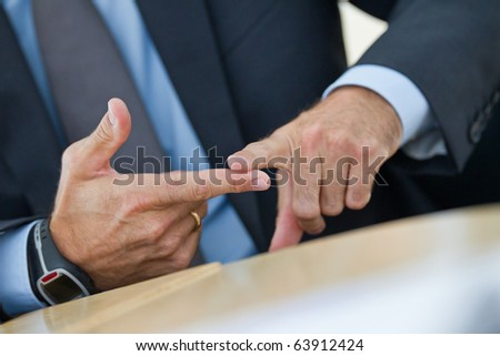 Manager shows two fingers in a conversation to itemize something - stock photo
