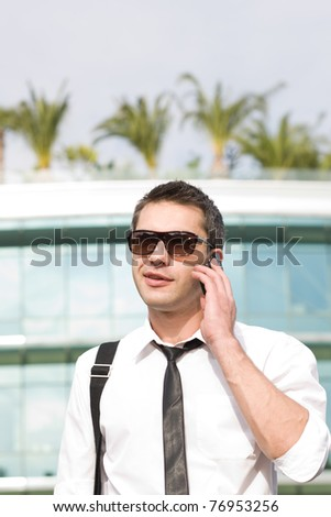 Manager speak on phone across office building