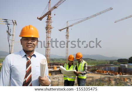 manager surveying on construction site - stock photo