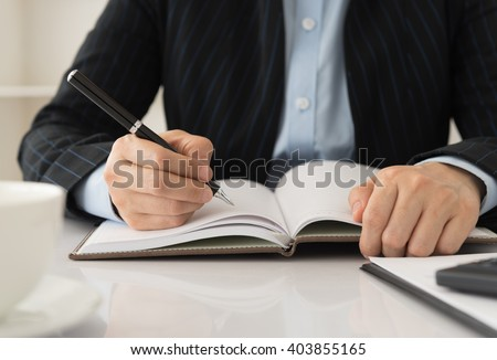 manager take notes personal organizer or planner on notebooks. - stock photo