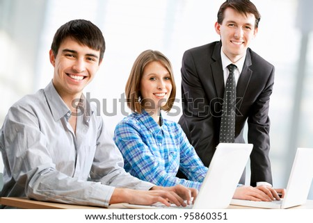 Manager talks to a young couple in the bank - stock photo