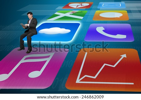 Manager using tablet sitting on shiny cloud app icons with tech background - stock photo