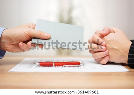 manager want to fired employee and he is showing Employee handbook which rules was  disobeyed - stock photo