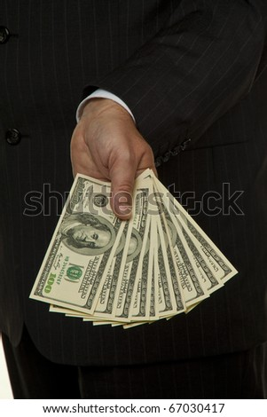 Manager with dollar bills in his hand - stock photo