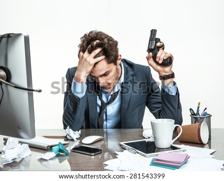 Manager with gun wants to commit suicide  / modern office man at working place, depression and crisis concept - stock photo