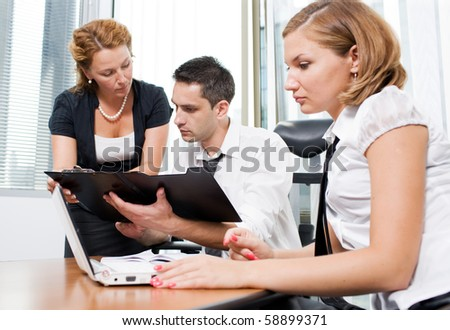 Manager with office workers on meeting in board room - stock photo