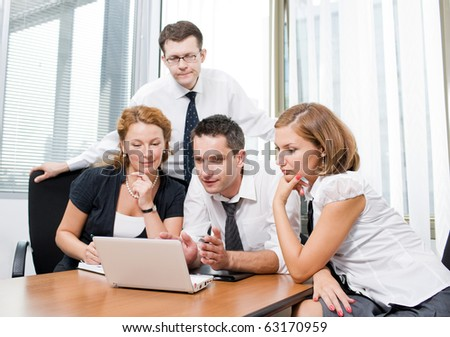 Manager with office workers on meeting in board room Hi Res - stock photo
